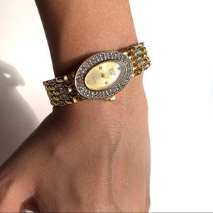 EJ Gold tone and rhinestone watch